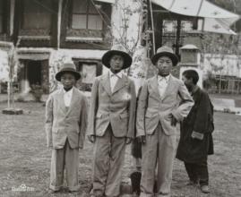 "Captioned as ""Aristocrat children wearing Western suits"""